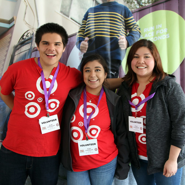 At the Play Everywhere Tour, powered by Target, volunteers pose for a photo.