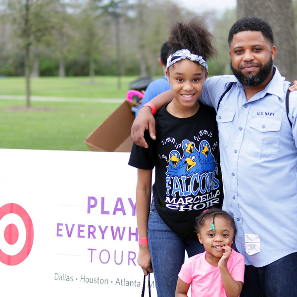 At the Play Everywhere Tour, powered by Target, a family poses for a photo.